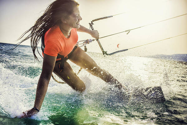 Smiling Young Female Kiteboarder On The Sea Art Print by Vm