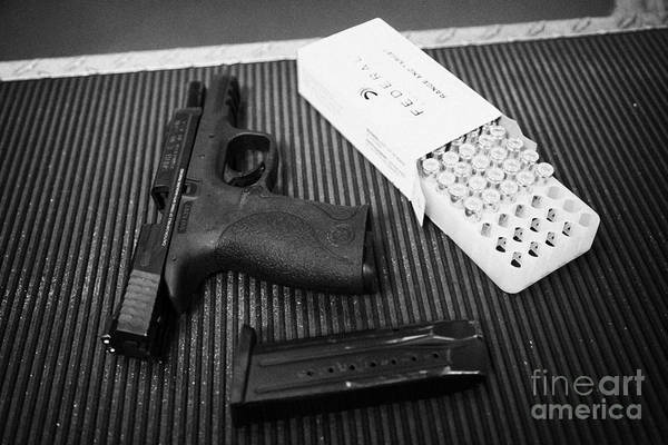 Wesson Photograph - Smith And Wesson 9mm Handgun With Ammunition At A Gun Range by Joe Fox