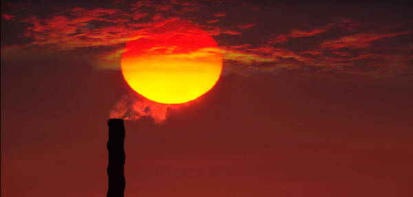 Concern Photograph - Smoke Stack In Sunset by Panoramic Images