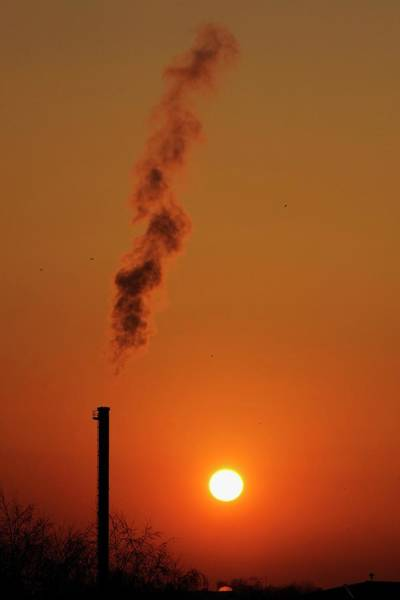 Sun Set Photograph - Smoking Chimney At Sunset by Danny Gys/reporters/science Photo Library
