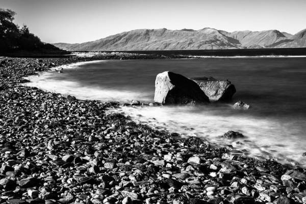 Photograph - Smooth Water Rocky Beach And Mountains by Dennis Dame