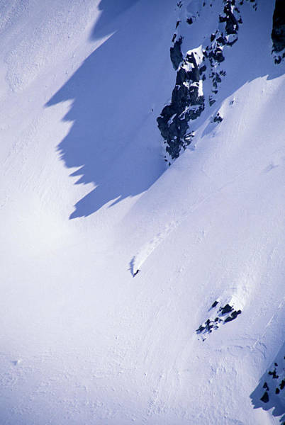 Wall Art - Photograph - Snowboarder Looks Small On A Massive by Aaron Black