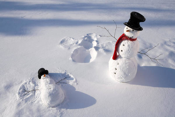 Winter Holiday Photograph - Snowmen In Forest Making Snow Angel by Kevin Smith