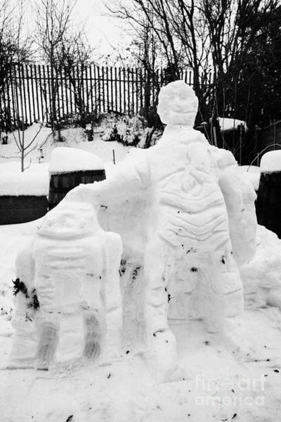 C3po Photograph - snowmen made to resemble star wars droids R2D2 and C3PO in garden of house by Joe Fox