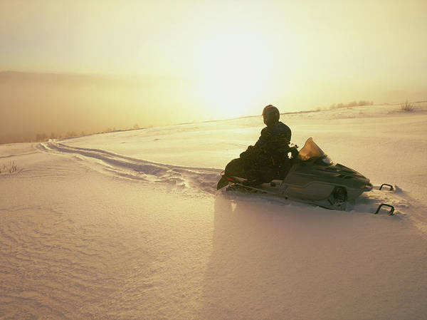End Of The Trail Photograph - Snowmobiler Sitting At The Top by Joel Sheagren