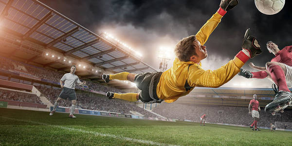 Team Sport Photograph - Soccer Goalie In Mid Air Save by Peepo