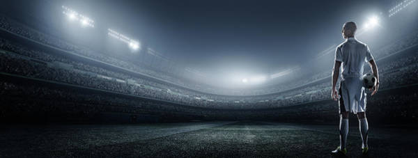 Competitive Sport Photograph - Soccer Player With Ball In Stadium by Dmytro Aksonov