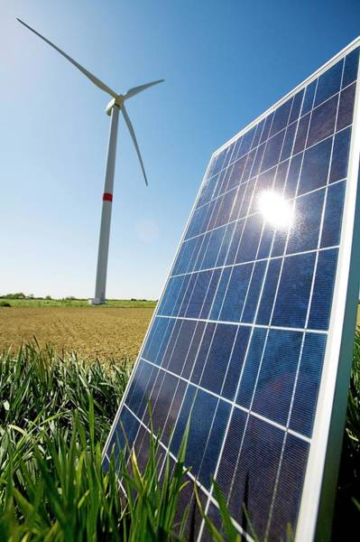 Solar Panels Photograph - Solar Panel And Wind Turbine by Claire Deprez/reporters/science Photo Library