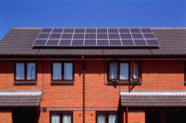 Solar Panels Photograph - Solar Panels On The Roof Of Terraced Houses by Alex Bartel/science Photo Library