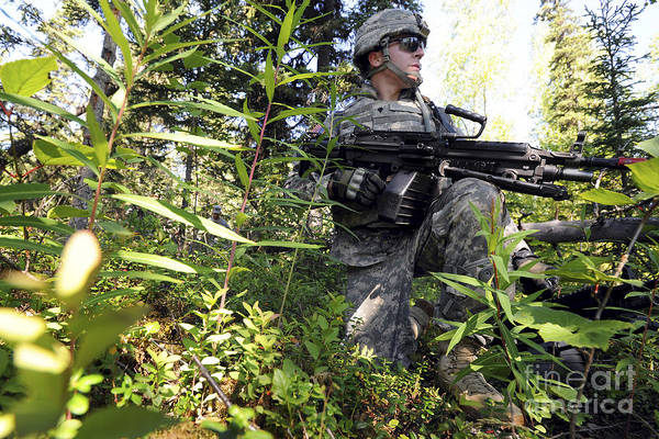 Elmendorf Photograph - Soldier Pulls Security At Joint Base by Stocktrek Images