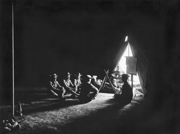Campsite Wall Art - Photograph - Soldiers At Camp At Night by Underwood Archives