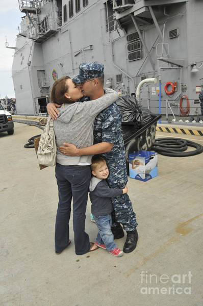 Station To Station Photograph - Sonar Technician Kisses His Wife by Stocktrek Images