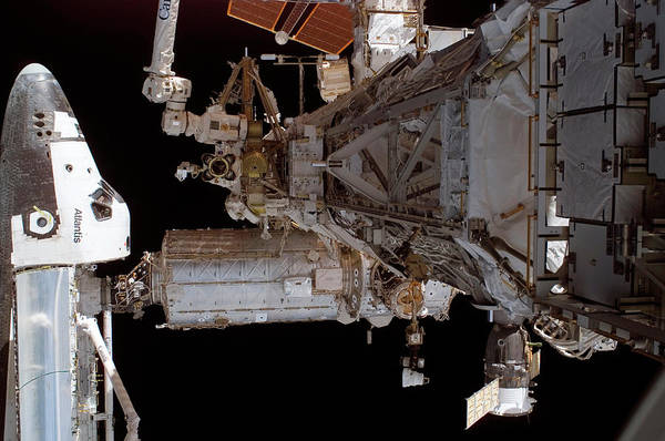 Iss Photograph - Space Shuttle Atlantis Docked On The Iss by Nasa/science Photo Library