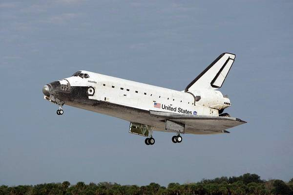 Space Shuttle Photograph - Space Shuttle Atlantis Landing by Nasa/science Photo Library