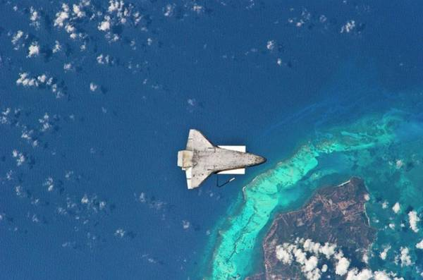 Isla Wall Art - Photograph - Space Shuttle Undocked From Iss by Nasa/science Photo Library
