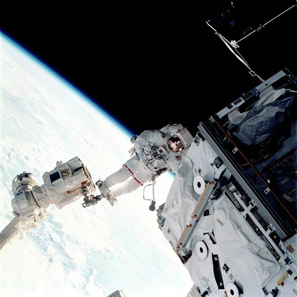 International Space Station Photograph - Space Walk On The Iss by Nasa/science Photo Library