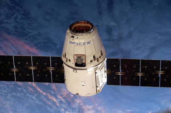 Nasa Photograph - Spacex Dragon Capsule At The Iss by Nasa