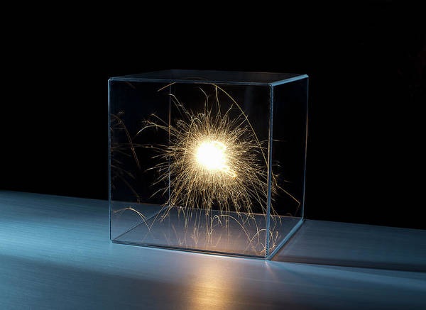 Trapped Photograph - Sparks In A Clear Box by Pm Images
