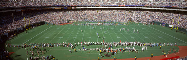 Detroit Lions Photograph - Spectator Watching A Football Match by Panoramic Images