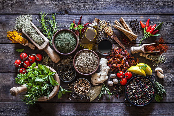 Spices And Herbs On Rustic Wood Kitchen Table Art Print by Fcafotodigital