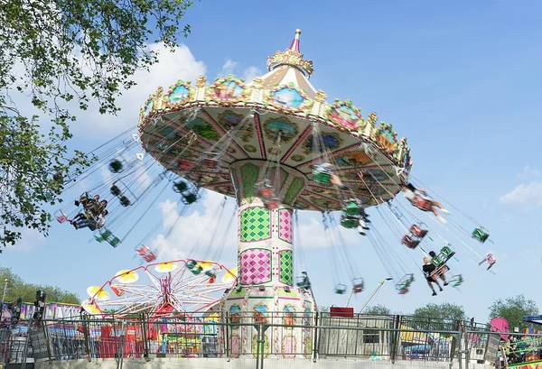 Fair Ground Photograph - Spinning Chair Ride At A Funfair by Cordelia Molloy/science Photo Library