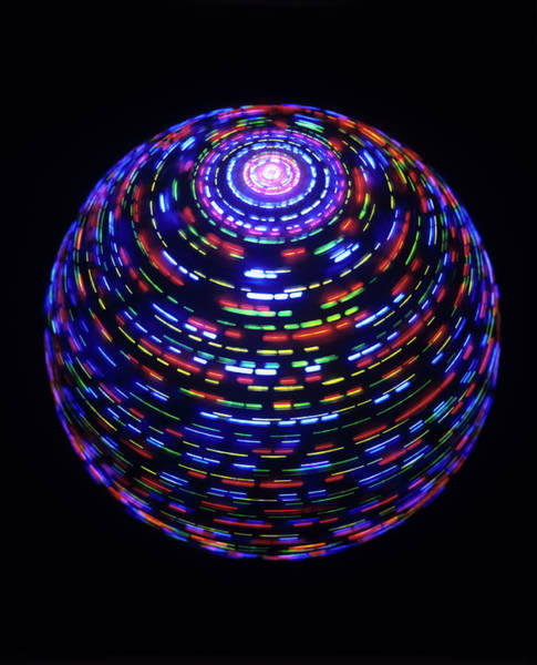 Wall Art - Photograph - Spinning Globe by Lawrence Lawry