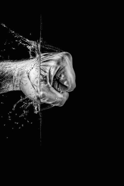 Photograph - Splashing Fist by Peter Lakomy