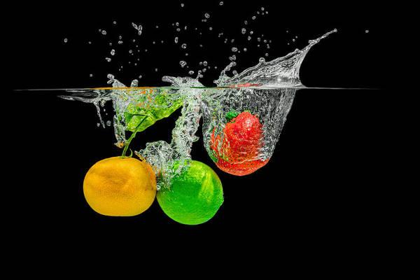 Photograph - Splashing Fruits by Peter Lakomy