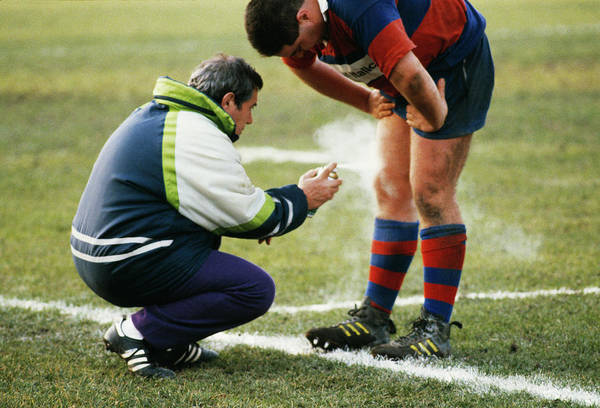 Sportsmen Photograph - Sportsman Recieving Treatment by Mauro Fermariello/science Photo Library