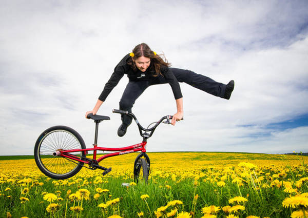 Photograph - Spring Has Sprung - Bmx Flatland Artist Monika Hinz Jumping In Yellow Flower Meadow by Matthias Hauser