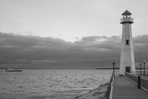 St Ignace Wall Art - Photograph - St Ignace Lighthouse And Boat  by John McGraw
