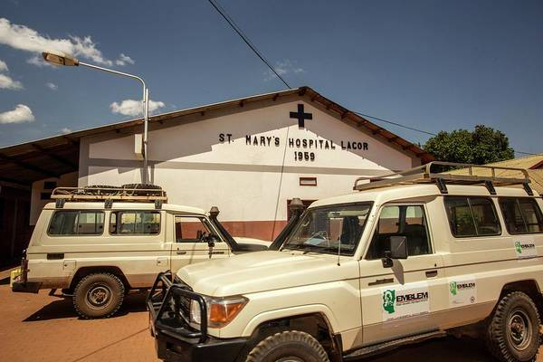 St. Mary Photograph - St Mary's Hospital And Transport Vehicles by Mauro Fermariello/science Photo Library