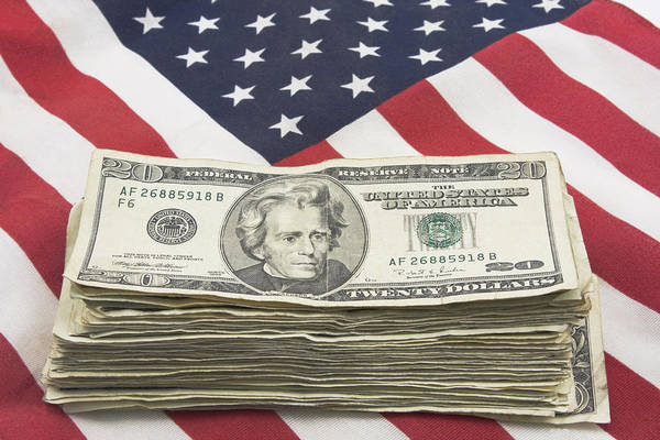 Capitalism Wall Art - Photograph - Stack Of Money On American Flag  by Keith Webber Jr