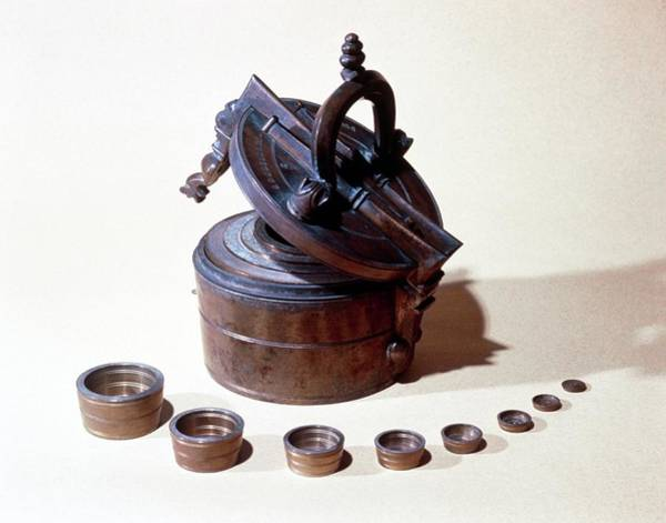 Wall Art - Photograph - Stack Of Receptacles (10th Century) For Weighing. by Jean-loup Charmet/science Photo Library