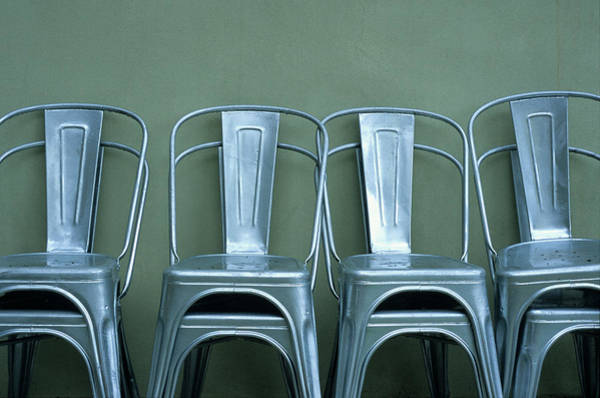 Wall Art - Photograph - Stacked Silver Metal Chairs by Ron Koeberer