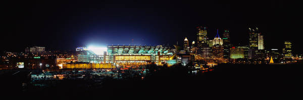 Wall Art - Photograph - Stadium Lit Up At Night In A City by Panoramic Images