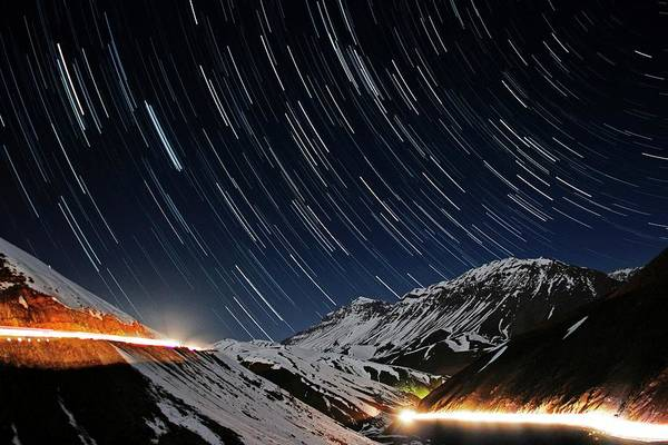 Star Track Wall Art - Photograph - Star Trails Over A Mountain Road by Babak Tafreshi/science Photo Library