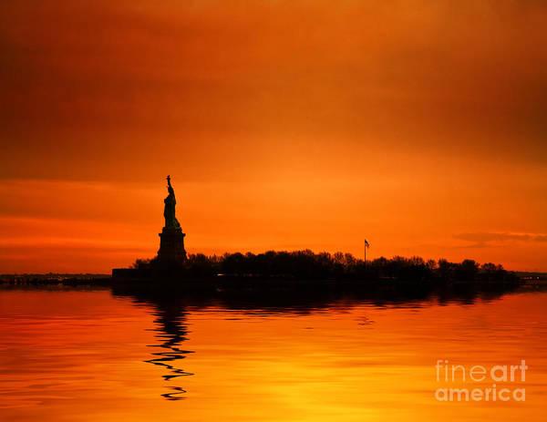 Wall Art - Photograph - Statue Of Liberty At Sunset by John Farnan