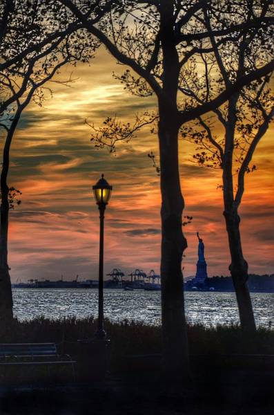 Park Bench Photograph - Statue Of Liberty From Battery Park by Marianna Mills