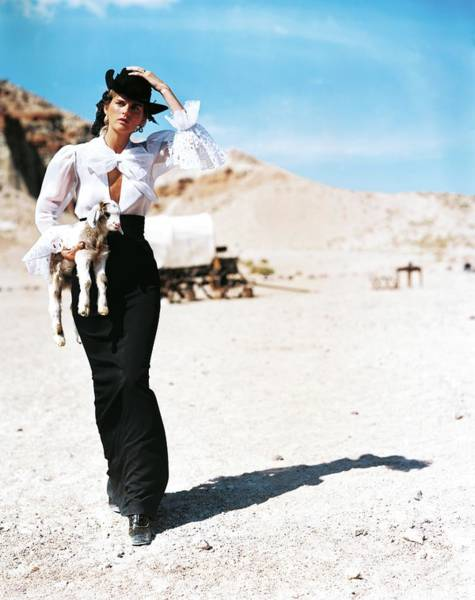Animal Photograph - Stella Tennant Carrying A Lamb by Arthur Elgort