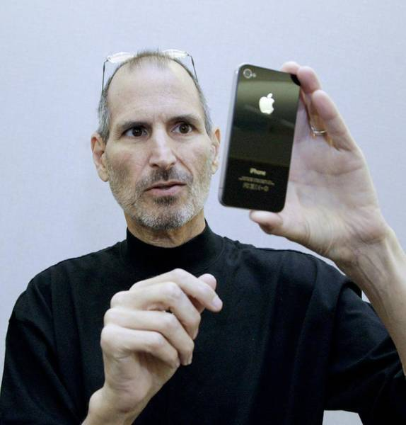 Macintosh Apple Photograph - Steve Jobs Holding An Iphone 4 by Science Photo Library