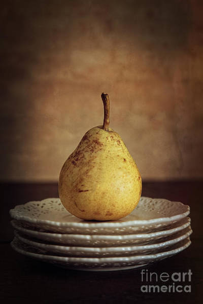 Photograph - Still Life Of A Pear On Plates by Sandra Cunningham