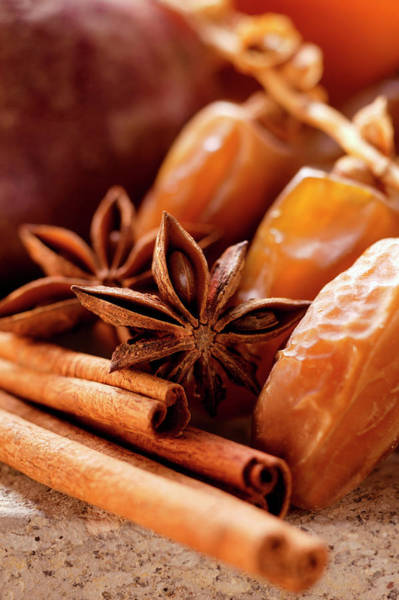Wall Art - Photograph - Still Life With Dates, Star Anise And Cinnamon Sticks by Foodcollection
