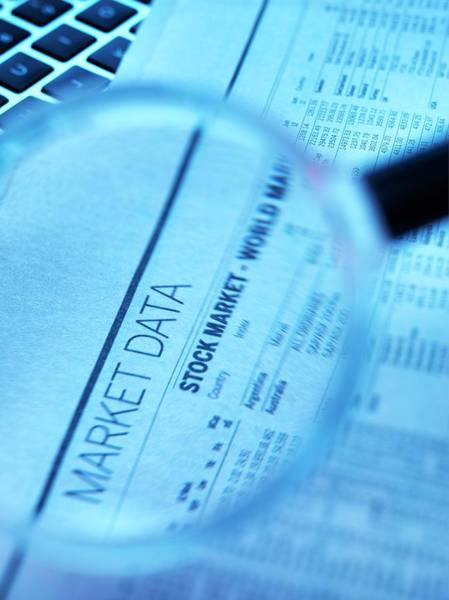 Shares Photograph - Stock Market Figures And Magnifying Glass by Tek Image