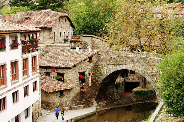 Stone Bridge Over River Running Through Art Print