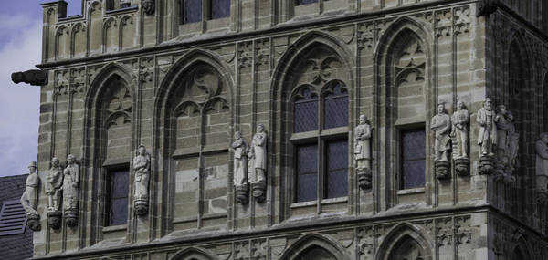 Glockenspiel Photograph - Stone Carvings On The Rathaus Tower Cologne by Teresa Mucha