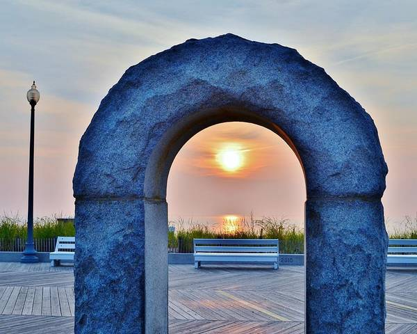 Photograph - Sunrise Through The Arch - Rehoboth Beach Delaware by Kim Bemis