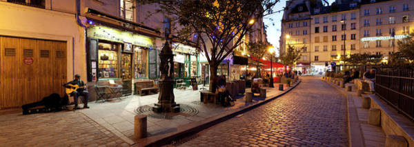 Wall Art - Photograph - Stores At Dusk, Paris, Ile-de-france by Panoramic Images