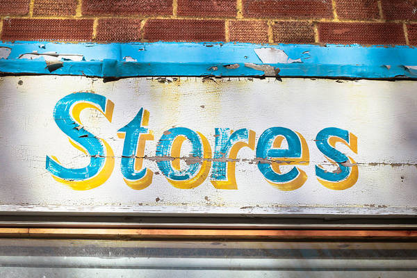 Mottled Wall Art - Photograph - Stores Sign by Tom Gowanlock