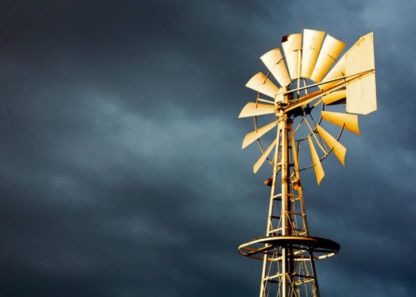 Windmills Photograph - Stormy Skies by Todd Klassy